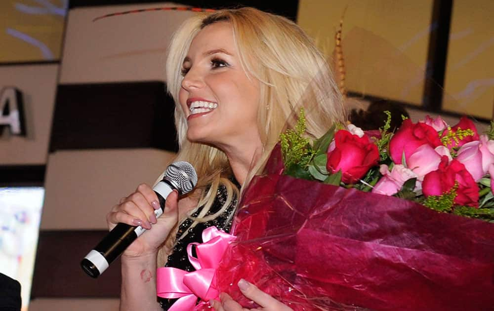 Singer Britney Spears speaks to the crowd after arriving at Planet Hollywood Resort & Casino before the debut of her new Las Vegas residency