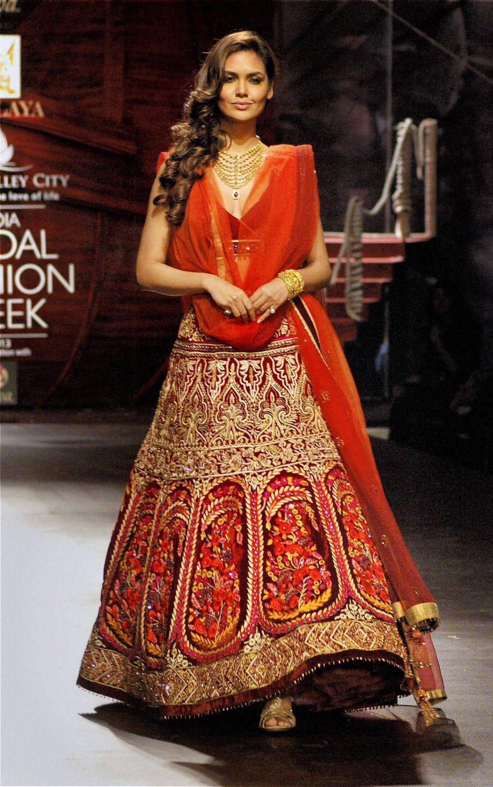 Bollywood actress Esha Gupta walks the ramp at the India Bridal Fashion Week in Mumbai.