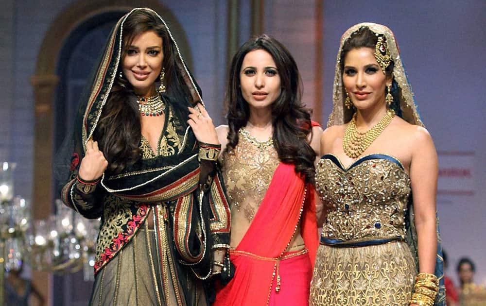 Fashion designer Mandira Wirk with actors Sahar Biniaz & Sophie Choudry at India Bridal Fashion Week 2013 in Mumbai.