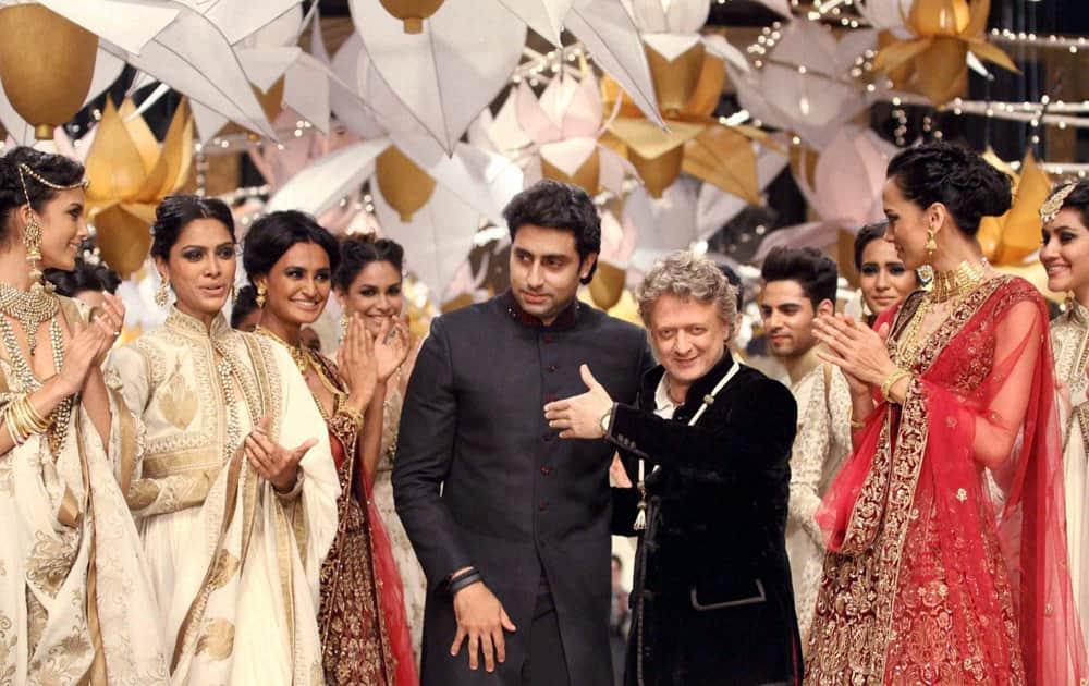 Abhishek Bachchan along with models walks the ramp for designer Rohit Bal during grand finale of India Bridal Fashion Week in Mumbai.