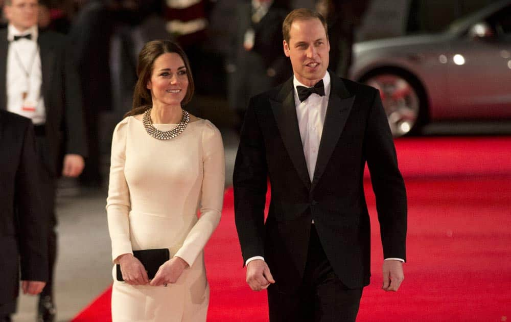 Britain's Kate, Duchess of Cambridge and her husband Prince William arrive to attend the UK premiere of the movie
