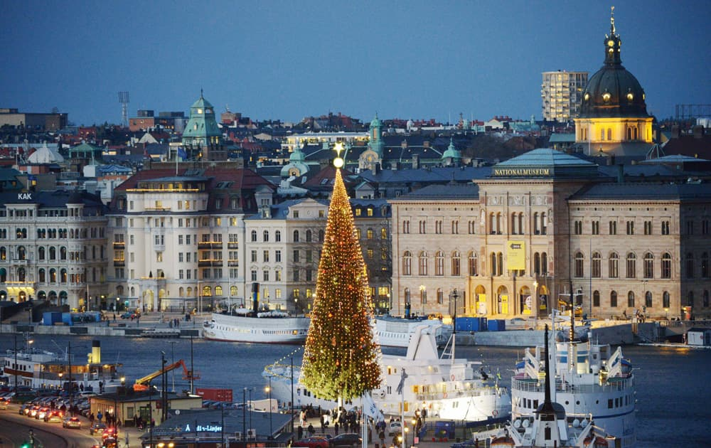 A 36-metre tall traditional Christmas tree is lit up on the first Sunday of Advent at Skeppsbron in central Stockholm.