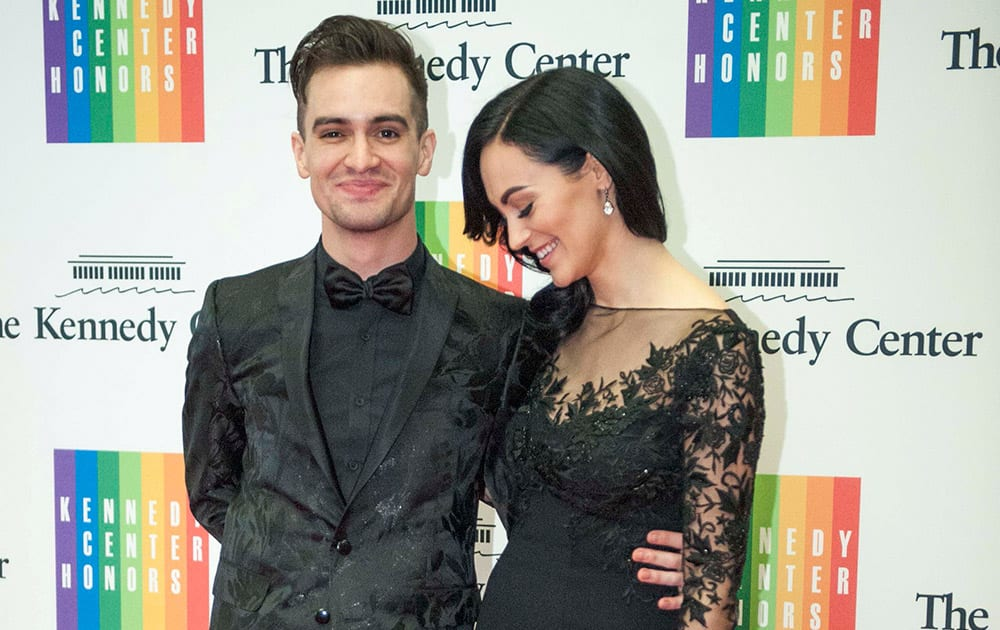 Brendon Urie and his wife, Sarah, arrive at the State Department for the Kennedy Center Honors gala dinner in Washington.