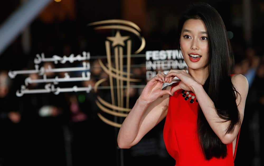 Japanese actress Youshikoura Aoi poses for photographers at the 13th Marrakech International film festival.