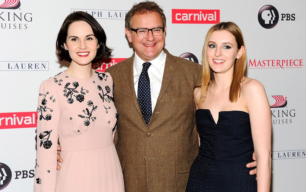 Actors Michelle Dockery, left, Hugh Bonneville and Laura Carmichael attend the `Downton Abbey` cast photo call at the Millennium Hotel in New York.