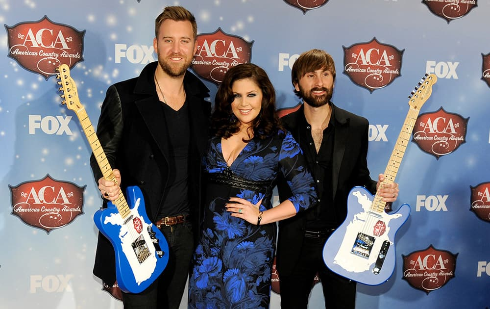 From left, Charles Kelley, Hillary Scott and Dave Haywood, of musical group Lady Antebellum, pose backstage with the award for single of the year: group and artist of the year: group, at the American Country Awards at the Mandalay Bay Resort & Casino in Las Vegas.