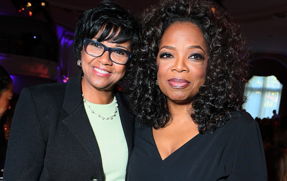 Cheryl Boone Isaacs, left, President, The Film Academy and Oprah WInfrey attend The Hollywood Reporter's celebration of power 100 women in entertainment breakfast in Beverly Hills, Calif.