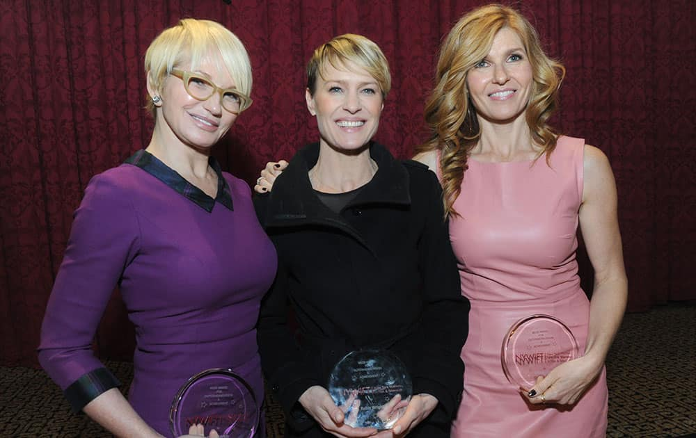 Ellen Barkin, Robin Wright and Connie Britton, left to right, pose together after the 2013 Muse Awards, presented by New York Women in Film & Television.
