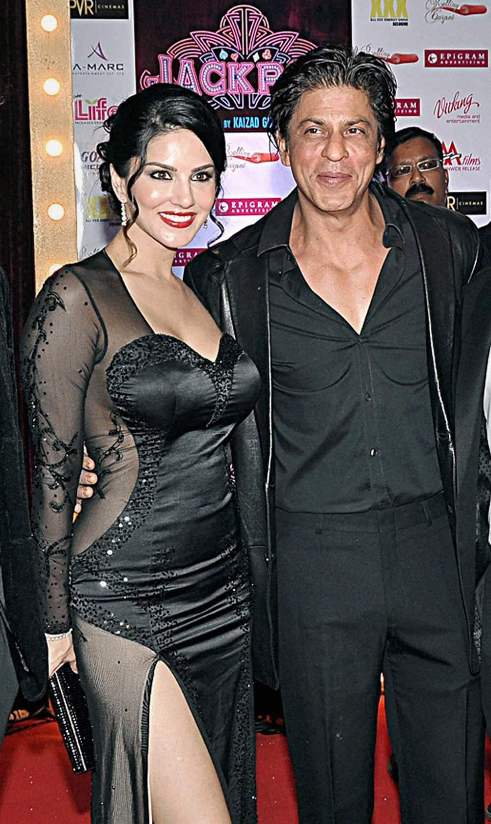 Sunny Leone with Shah Rukh Khan during the premiere of her upcoming movie 'Jackpot', in Mumbai.