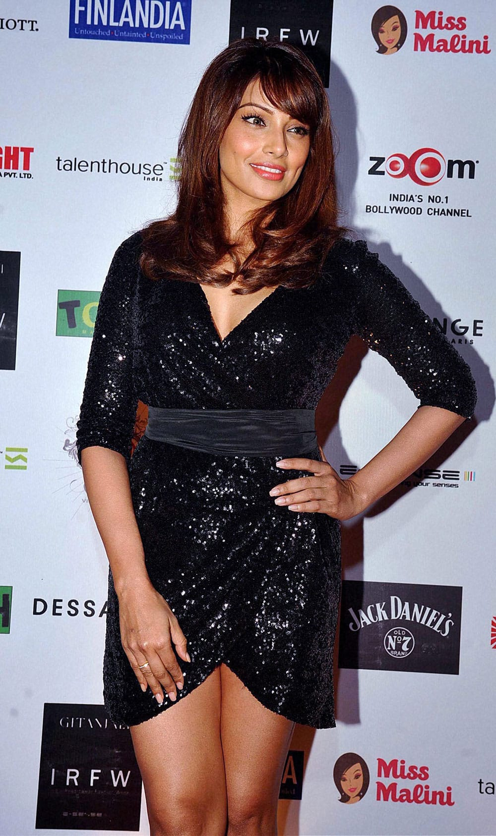 Bollywood actress Bipasha Basu poses for photographers during the 3rd edition of India Resortwear Fashion Week (IRFW) 2013 in Mumbai.