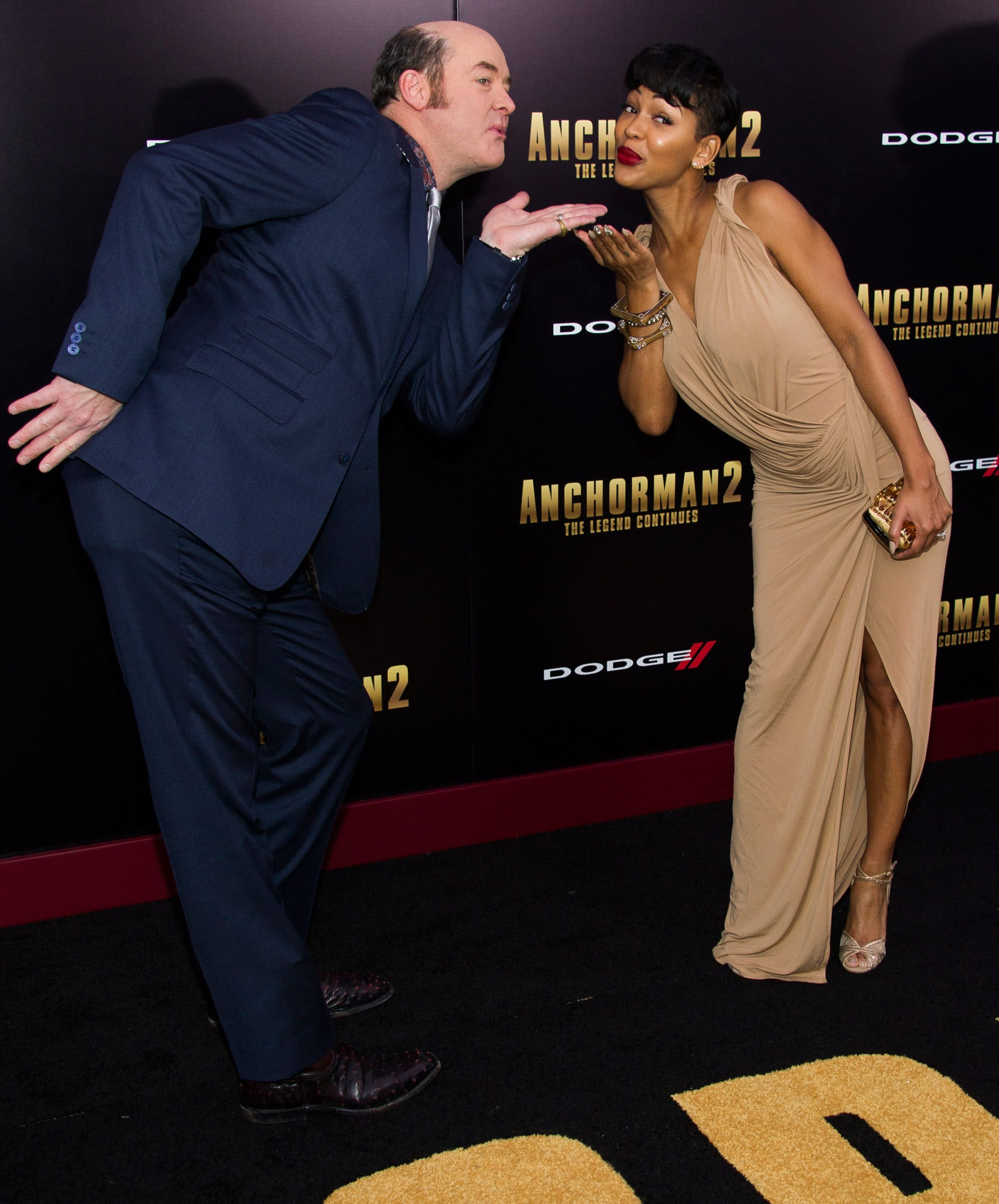 David Koechner, left, and Meagan Good attend the `Anchorman 2: The Legend Continues` premiere in New York.