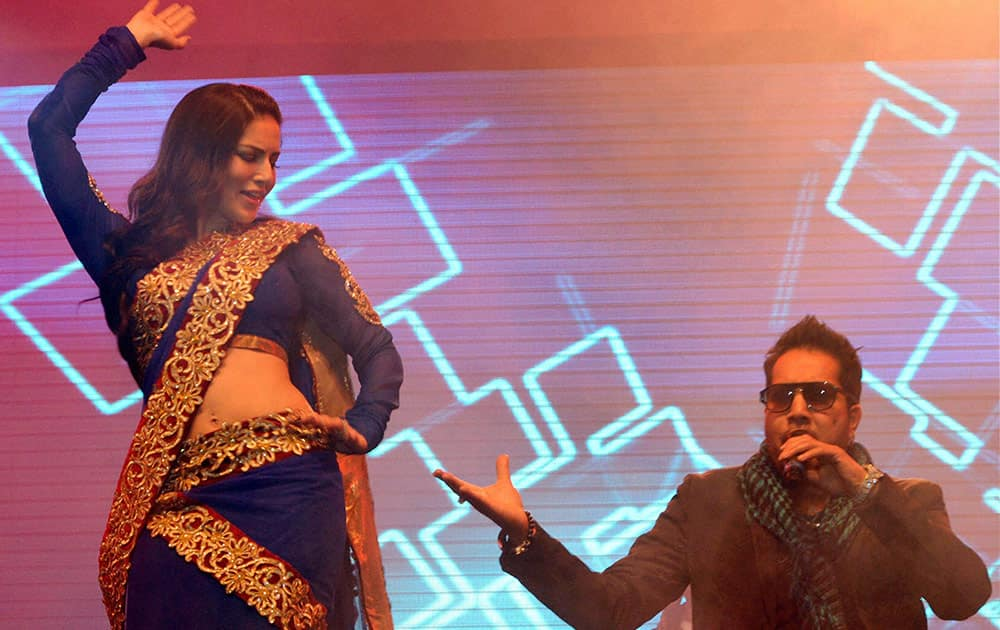 Bollywood actress Sunny Leone performs with singer Mika Singh during a musical concert in Gurgaon.