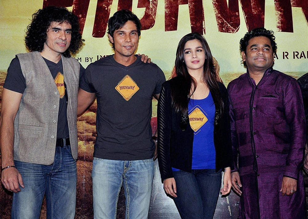 Bollywood director Imtiaz Ali with actors Randeep Hooda, Alia Bhatt and music composer A R Rahman during the launch of first look of the film Highway in Mumbai.
