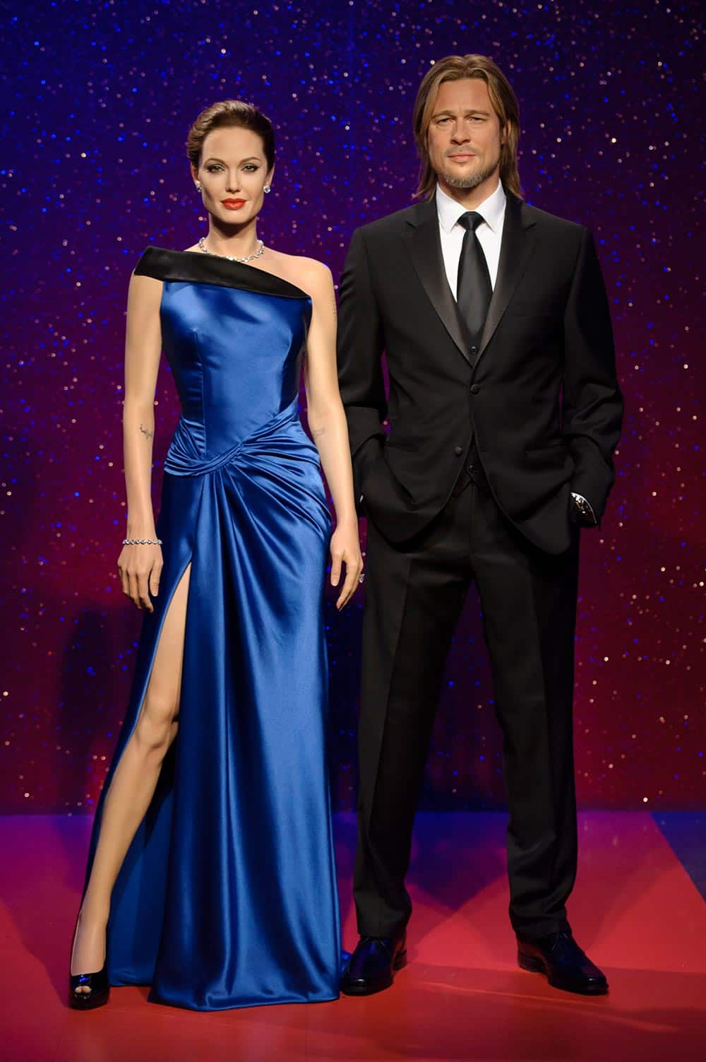 Wax figures of Hollywood actors Angelina Jolie and Brad Pitt are displayed in the party area of the wax museum.