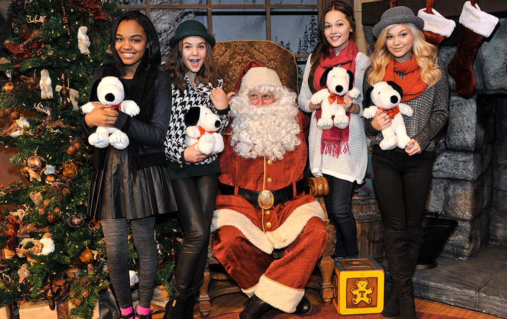 From left, China Anne McClain, Bailee Madison, Santa Claus, Kelli Berglund, and Olivia Holt attend Snoopy's Merriest Tree Lighting at Knott's Berry Farm, in Buena Park, Calif.