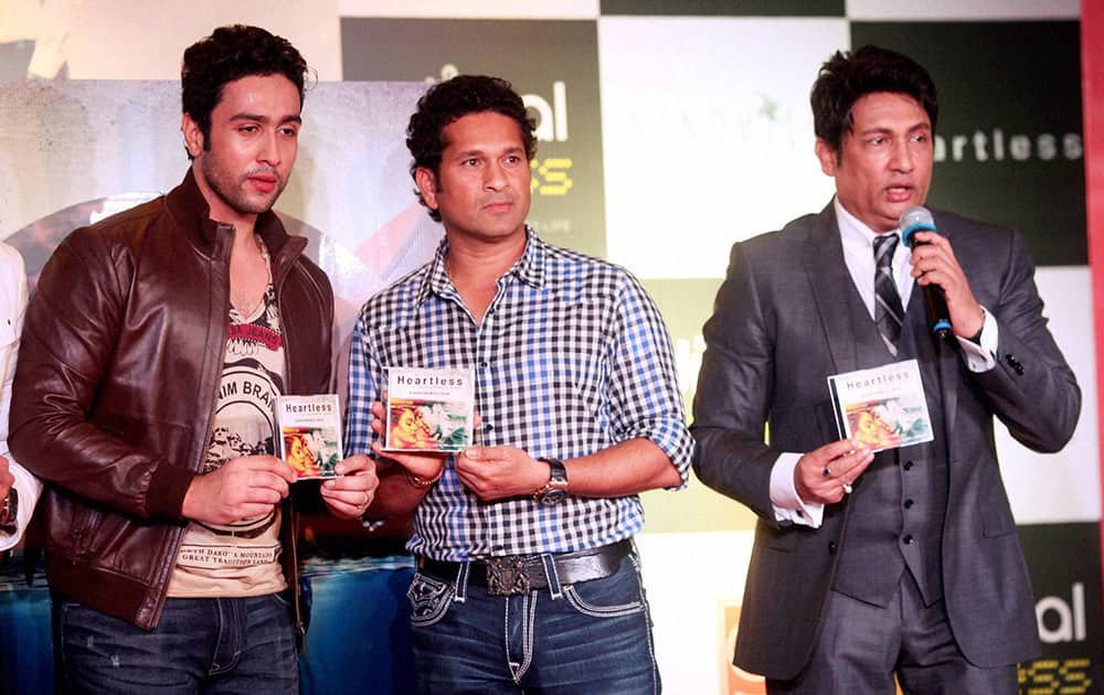 Former Indian captain Sachin Tendulkar launches the music of Shekhar Suman's 'Heartless' in Mumbai. Shekhar Suman's son Adhyayan Suman is also seen in the picture.