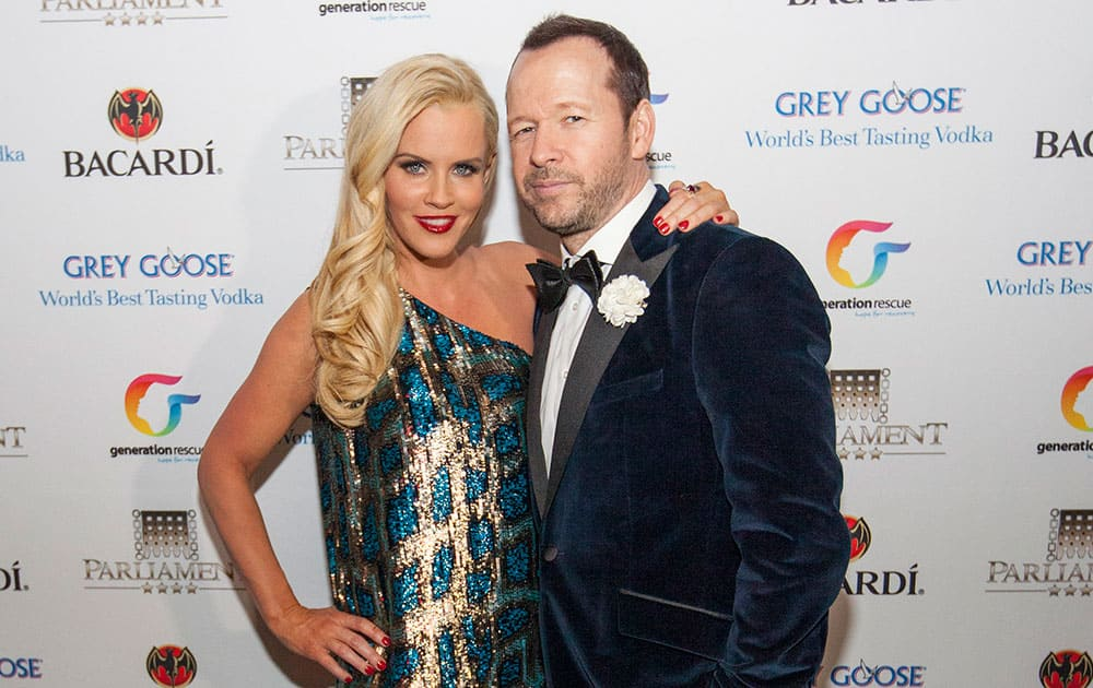 Jenny McCarthy, left, and Donnie Wahlberg pose at the Parliament night club for her bash to raise funds for the nonprofit Generation Rescue, which supports families dealing with autism in Chicago.