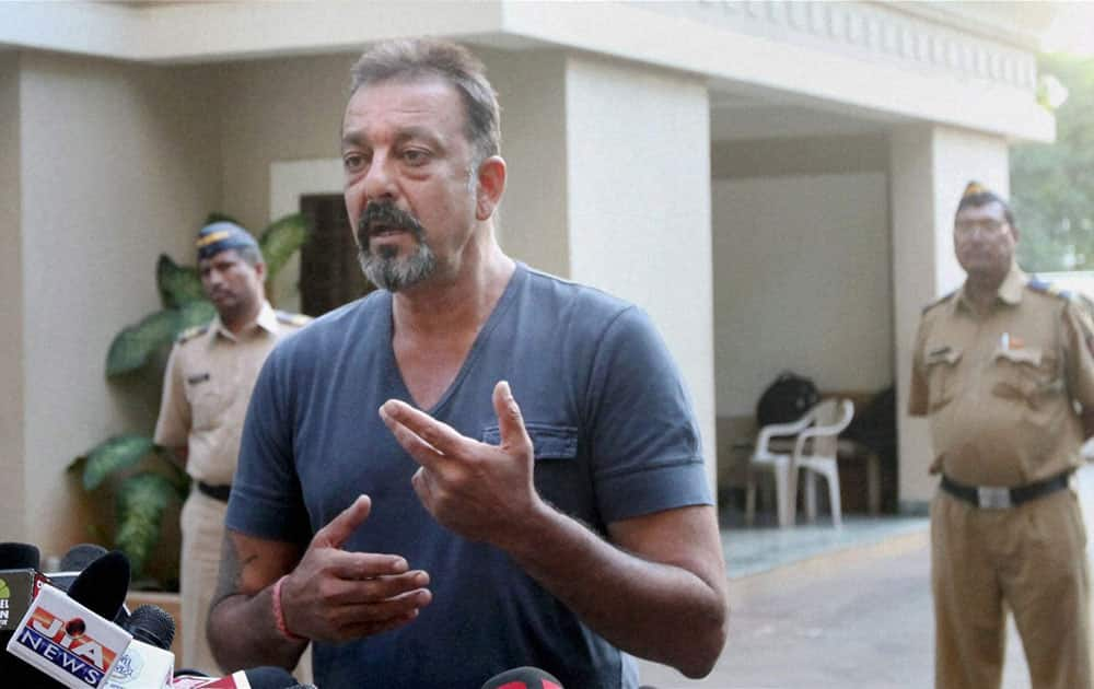 Actor Sanjay Dutt interacts with media after he was granted a month-long parole, the Bollywood actor was released from Pune's Yerwada Jail earlier.