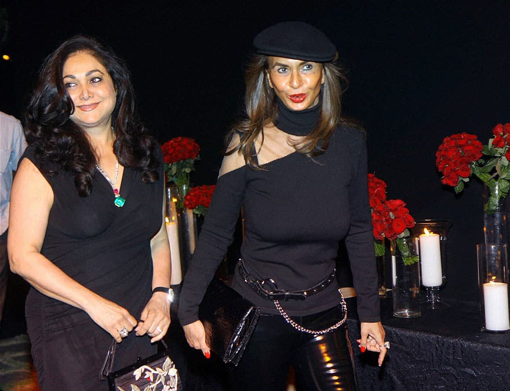 Philanthropist Tina Ambani (L) and socialite Parmeshwar Godrej arrive to attend a party hosted by actress Deepika Padukone in Mumbai.