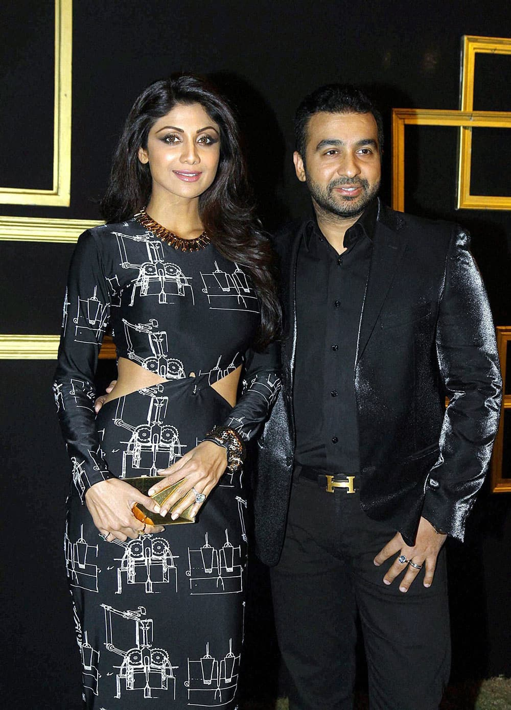 Bollywood actress Shilpa Shetty poses with her husband Raj Kundra as they arrive to attend a party hosted by actress Deepika Padukone in Mumbai.