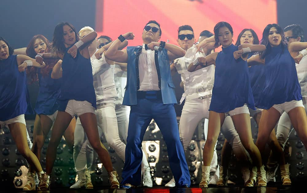 South Korean rapper PSY, center, performs during his concert `All Night Stand` in Seoul, South Korea.