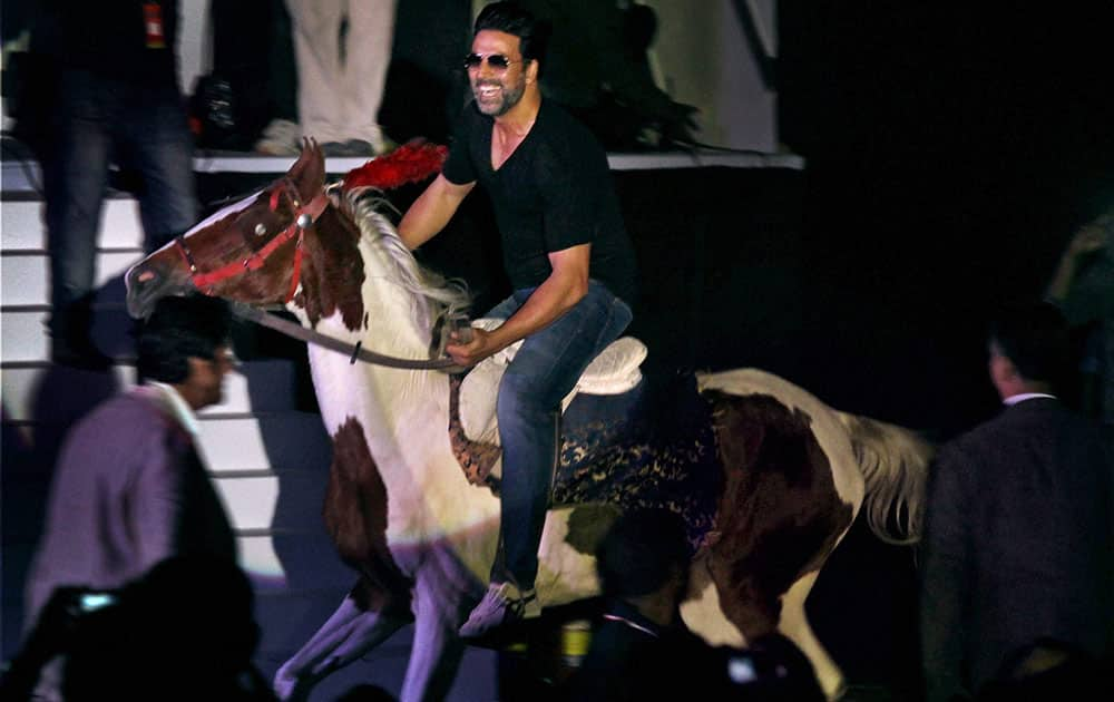 Bollywood actor Akshay Kumar riding a horse during the pre-centenary celebrations of East Bengal Club at Salt Lake stadium in Kolkata.