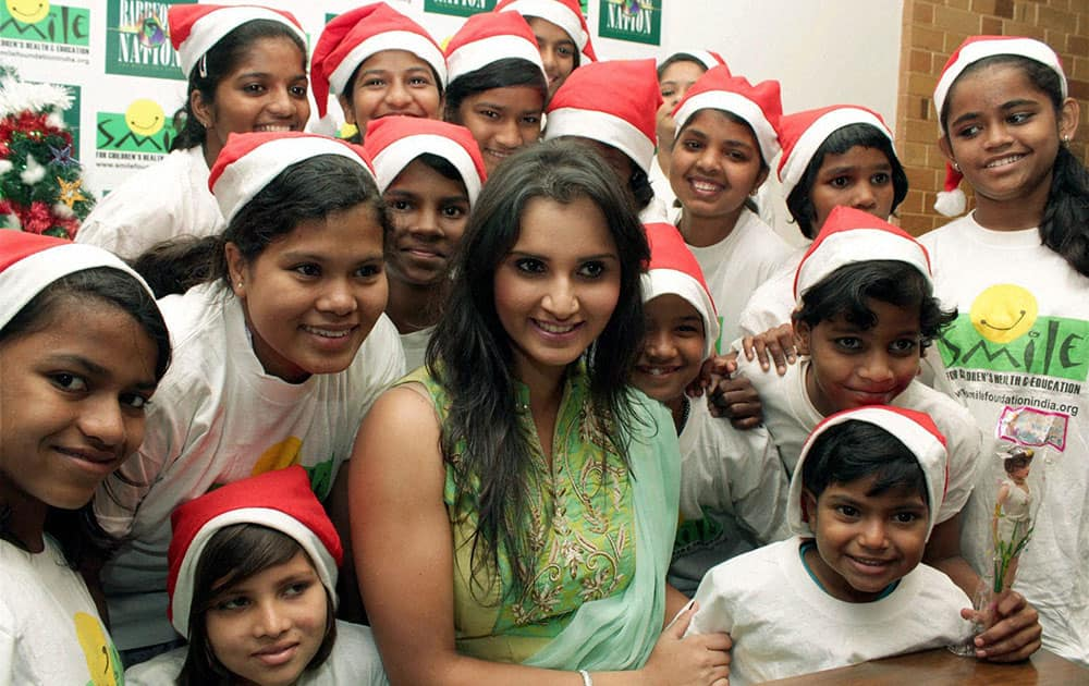 Tennis player Sania Mirza celebrating Christmas with under privileged children in Mumbai.