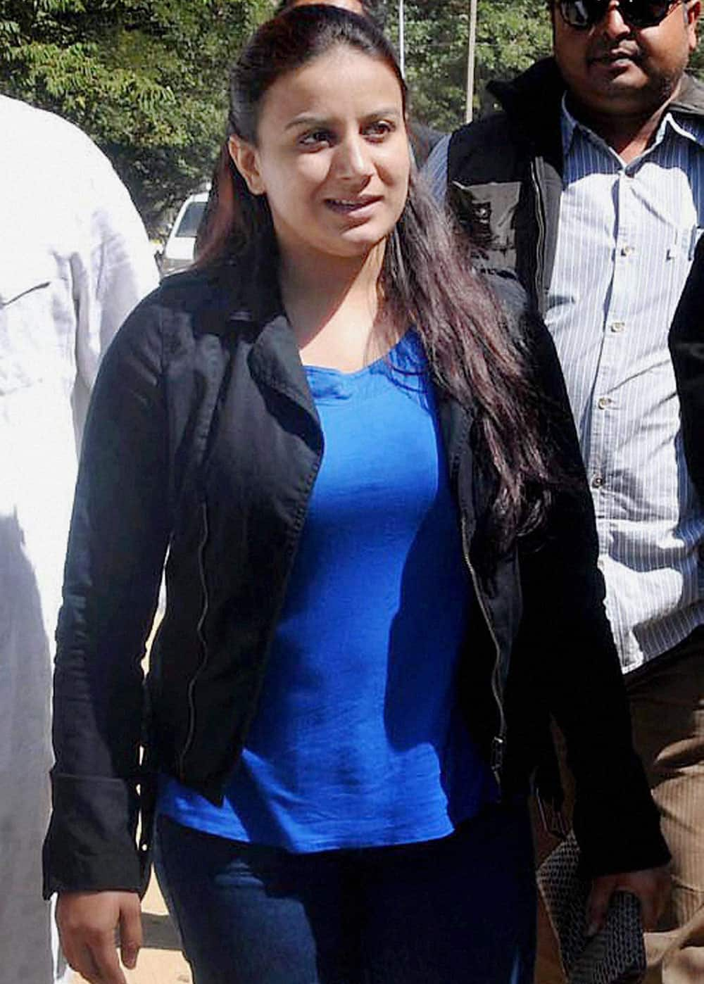 Kannada actress Pooja Gandhi arrives to appear before the court in Chikmagalur in Karnataka on Monday in connection with a case of violation of model code of conduct.