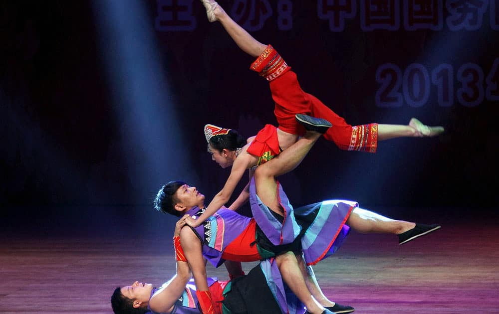Chinese artists perform during an event in connection with Christmas and New Year celebrations in Kolkata.
