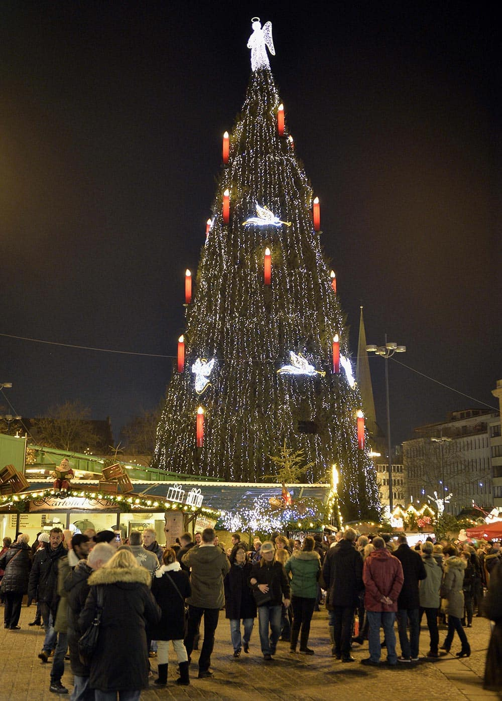 Germany's biggest Christmas tree shines in the center of a Christmas market in Dortmund, Germany.