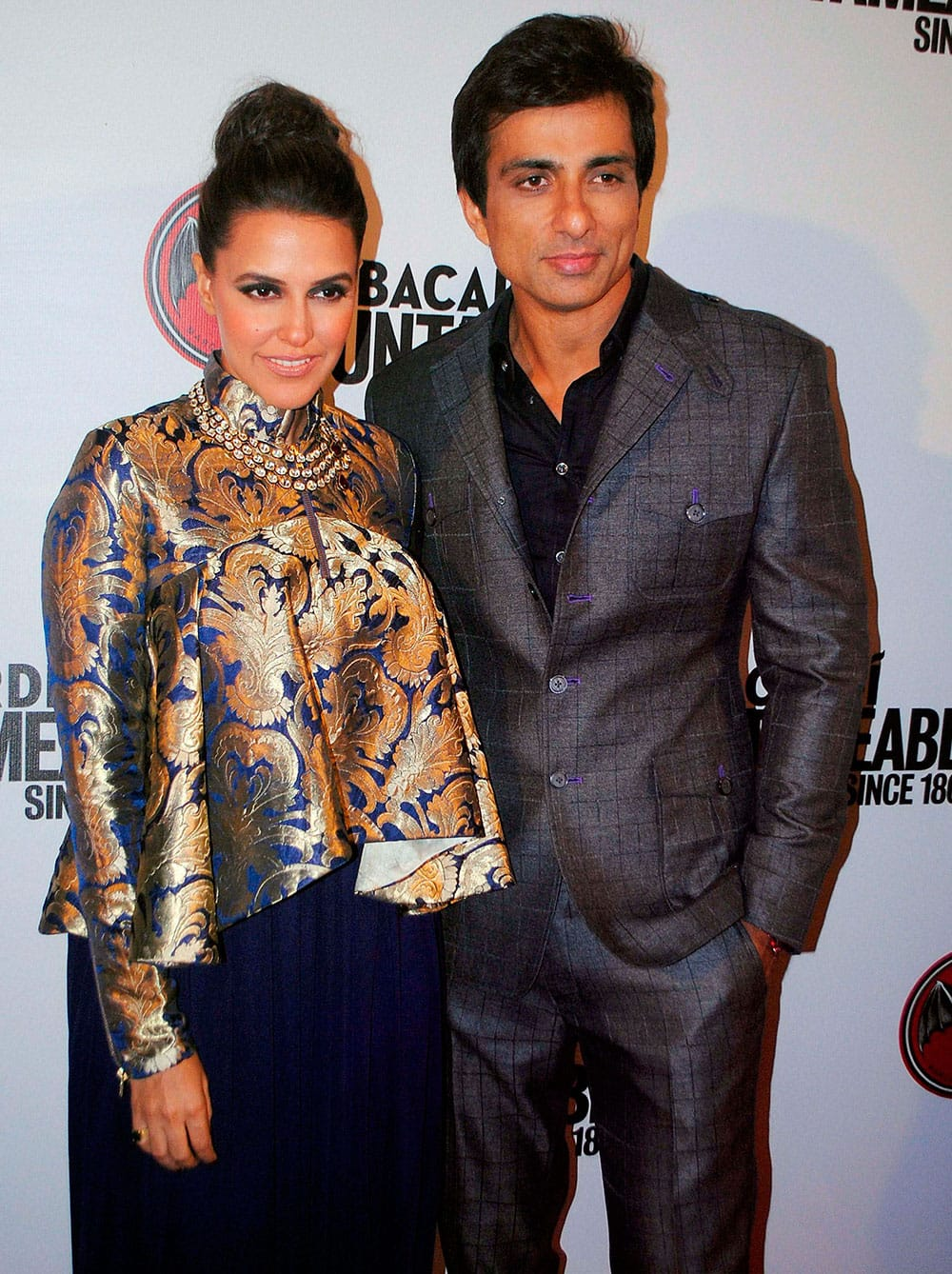 Bollywood actors Neha Dhupia and Sonu Sood participate in an event at Kingdom of Dreams in Gurgaon.