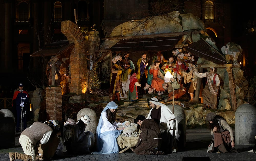 Dancers impersonating Mary, Joseph and St. Francis perform in front of the Nativity scene unveiled in St.Peter's Square at the Vatican.