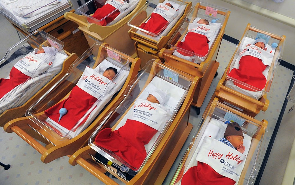 Newborns sleep in oversized red stockings in the nursery at Long Beach Memorial in Long Beach, Calif. For more than 50 years, babies born between Dec. 21-25 at Long Beach Memorial are placed in big red stockings to be presented to the new parents.