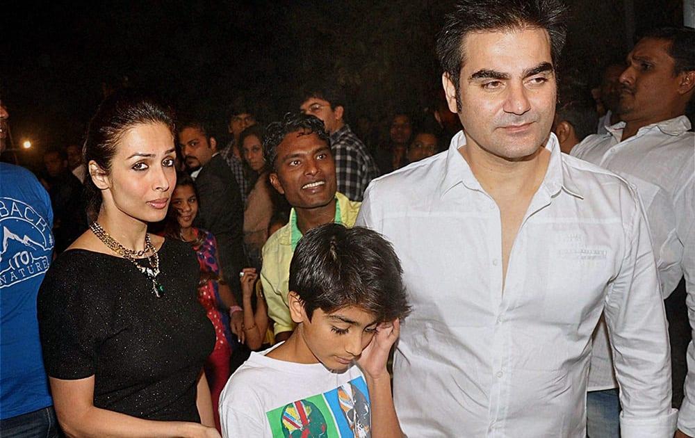 Malaika Arora Khan with her filmmaker husband Arbaaz Khan (R) and son Arhaan Khan attend the Midnight Mass on Christmas Eve at a church in Mumbai.