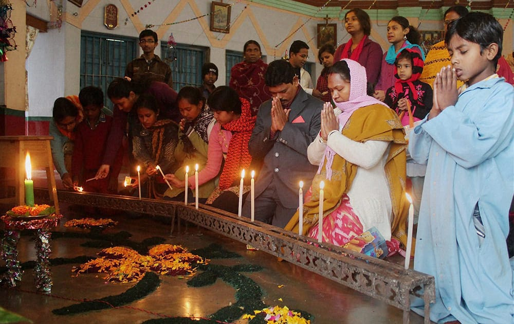 Devotees pray at a church on the occasion of Christmas in South Dinajpur district of West Bengal.
