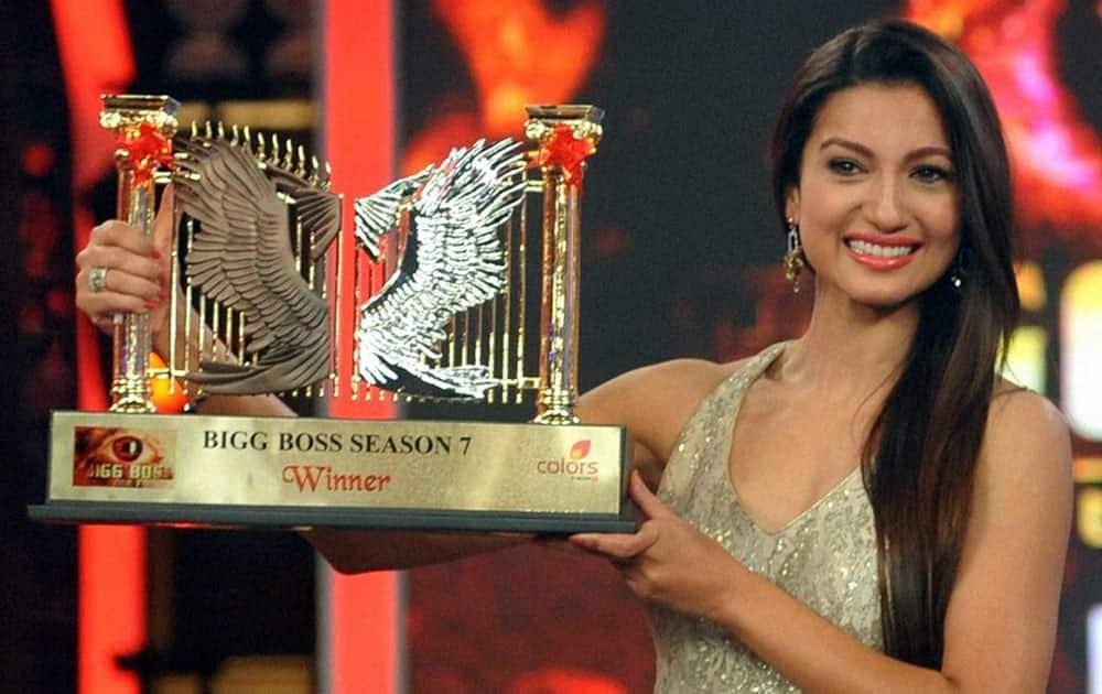 Big Boss season 7 winner Gauhar Khan displays award during the grand finale at Lonavala.