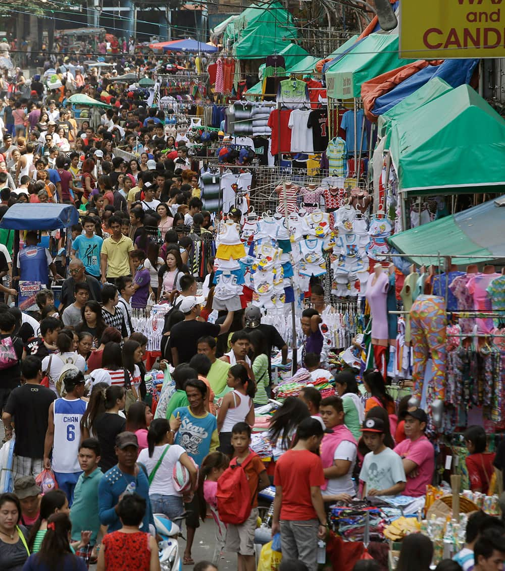 Hundreds of shoppers crowd Manila's commercial district of Divisoria to do last-minute shopping for the traditional celebration of welcoming the new year, in the Philippines.