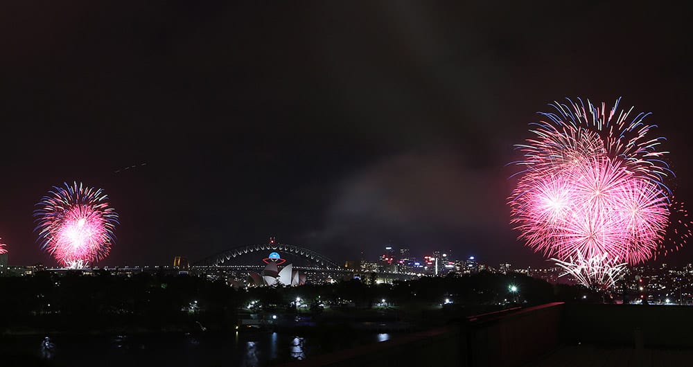 Fireworks explode near the Harbor Bridge and the Opera House during New Year's Eve celebrations in Sydney.