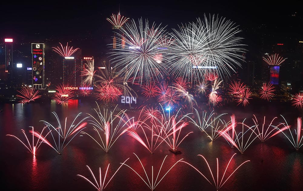 Fireworks explode at the Hong Kong Convention and Exhibition Centre over the Victoria Harbor during New Year's Eve to celebrate the start of 2014 in Hong Kong.