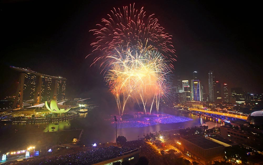 Fireworks explode over the financial district at midnight, in Singapore. Celebrations started on New Year's Eve where concerts were held and thousands gathered on the streets to usher in the Year 2014.