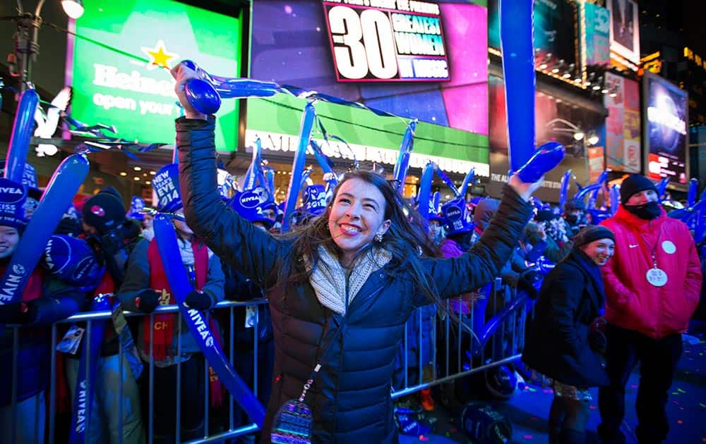 Betsy Bryant, of Nashville, dances in the buffer beside the performance stage during the New Year's Eve celebrations in Times Square, in New York.