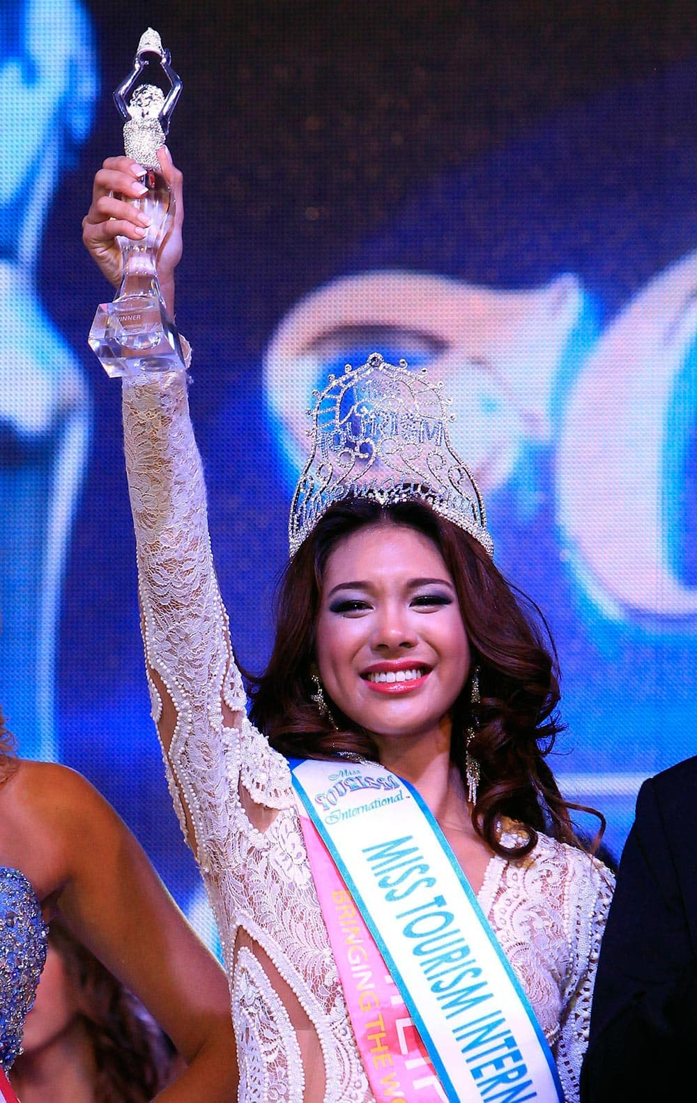 Angeli Dione Gomez of the Philippines shows off her trophy following her winning the Miss Tourism International 2013 World Final in Putrajaya, outside Kuala Lumpur, Malaysia.