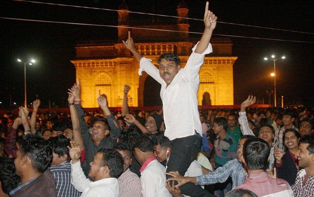 People celebrating the new year 2014 at the Gateway of India in Mumbai.