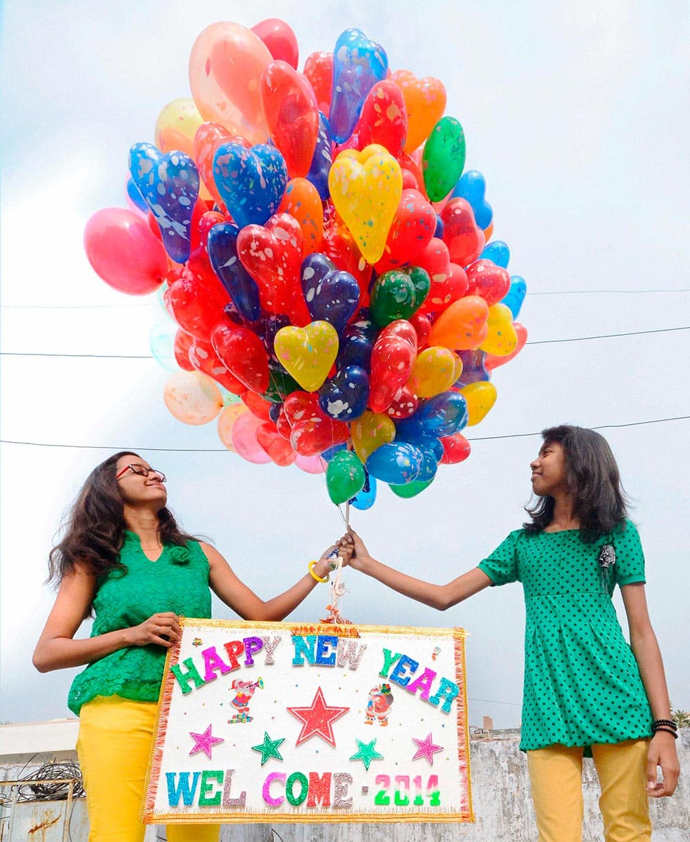 Christians gather at Church to release balloons on the occasion of New Year 2014 in Ahmedabad.