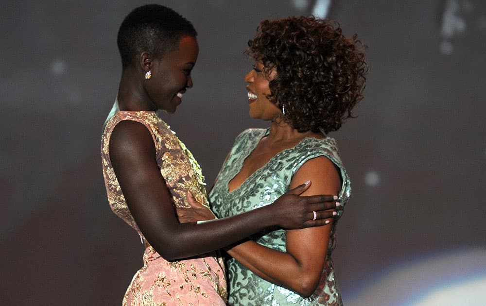 Alfre Woodard presents the breakthrough performance award to Lupita Nyong'o for `12 Years a Slave` at the Palm Springs International Film Festival Awards Gala at the Palm Springs Convention Center.