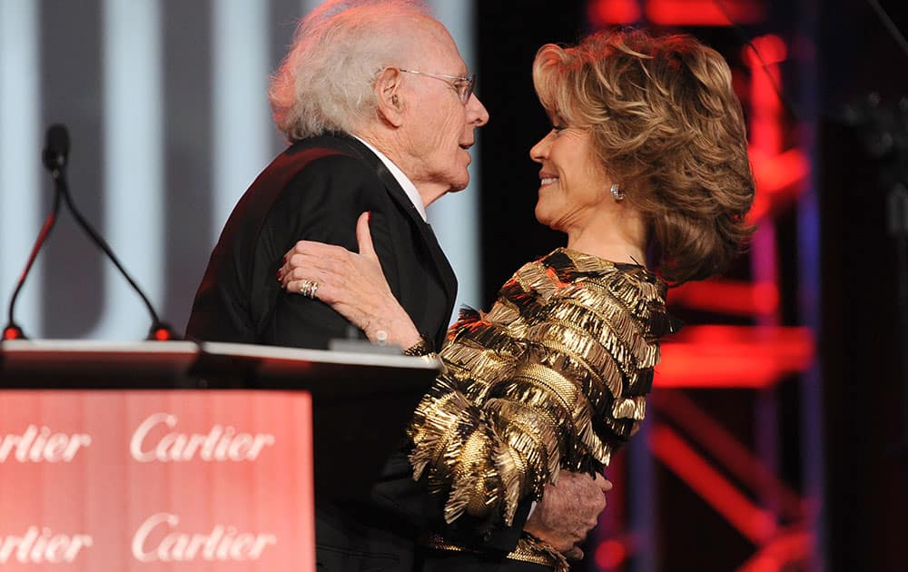 Jane Fonda, right, presents the career achievement award to Bruce Dern for `Nebraska` at the Palm Springs International Film Festival Awards Gala at the Palm Springs Convention Center.