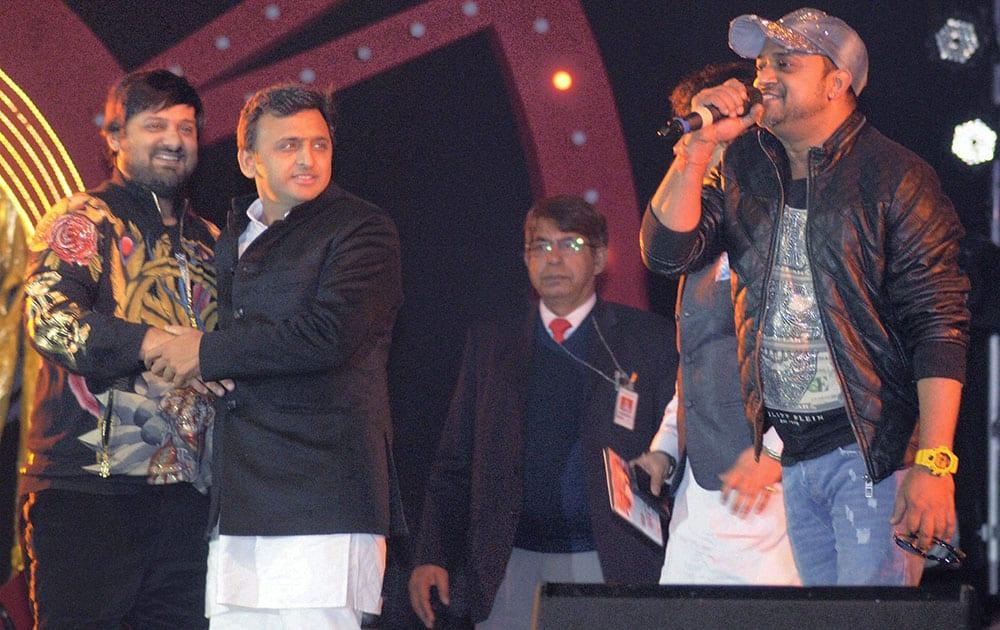 UP CM Akhilesh Yadav with music composers Sajid and Wajid at Saifai Mahotsav in Etawah district.