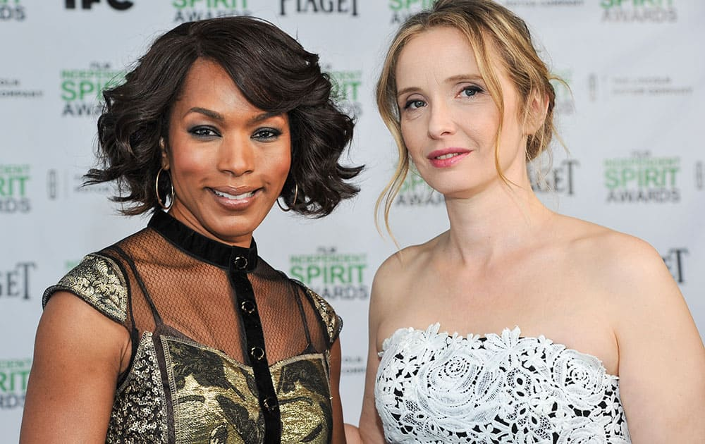 Angela Bassett, left, and Julie Delpy stand for a photo the 2014 Film Independent Filmmaker Grant and Spirit Awards Nominees Brunch in West Hollywood, Calif.