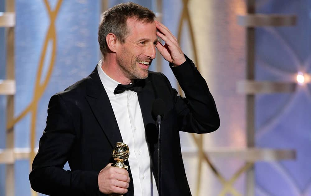 This image released by NBC shows Spike Jonze accepting the award for best screenplay in a motion picture for `Her` during the 71st annual Golden Globe Awards.