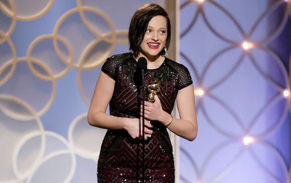 Elisabeth Moss accepting the award for best actress in a mini-series or TV movie for her role in `Top of the Lake` during the 71st annual Golden Globe Awards.